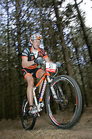 07 APR 2007 - THETFORD, UK - Anthony Roland makes his way through a wooded section during round 1 of the British Mountain Bike X Country series. (PHOTO (C) NIGEL FARROW)