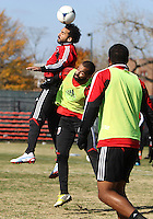 WASHINGTON, DC - NOVEMBER 14, 2012: Dwayne DeRosario (7) of DC United heads the ball over Maicon Santos (29) during a practice session before the second leg of the Eastern Conference Championship at DC United practice field, in Washington, DC on November 14.