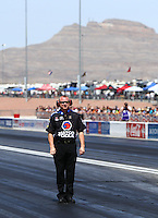 Apr 11, 2015; Las Vegas, NV, USA; A crew member for NHRA top fuel driver Antron Brown during qualifying for the Summitracing.com Nationals at The Strip at Las Vegas Motor Speedway. Mandatory Credit: Mark J. Rebilas-