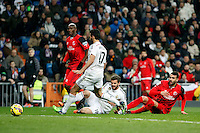 Arbeloa and Nacho of Real Madrid and Mbia and Alex Vidal of Sevilla during La Liga match between Real Madrid and Sevilla at Santiago Bernabeu Stadium in Madrid, Spain. February 04, 2015. (ALTERPHOTOS/Caro Marin) /NORTEphoto.com