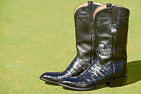 The Valero Texas Open boots await their new owner, Kevin Chappell (USA) on the 18th green following round 4 of the Valero Texas Open, AT&amp;T Oaks Course, TPC San Antonio, San Antonio, Texas, USA. 4/23/2017.<br /> Picture: Golffile | Ken Murray<br /> <br /> <br /> All photo usage must carry mandatory copyright credit (&copy; Golffile | Ken Murray)
