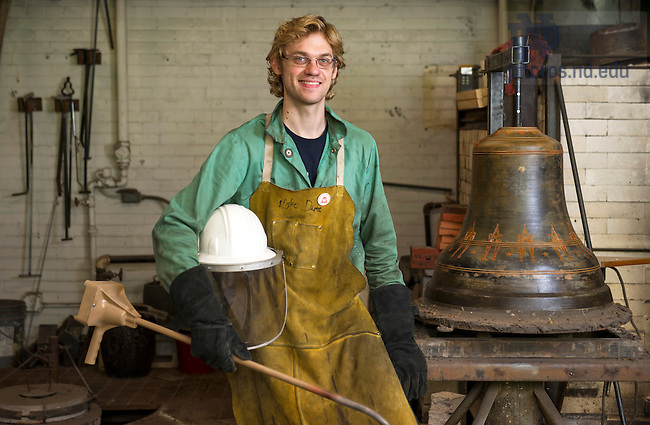 "Sept. 3, 2014; Graduate student Benjamin Sunderlin next to the loam mold of ""The Bell of Good Faith"" in his casting shop in Riley Hall. (Photo by Barbara Johnston/University of Notre Dame"