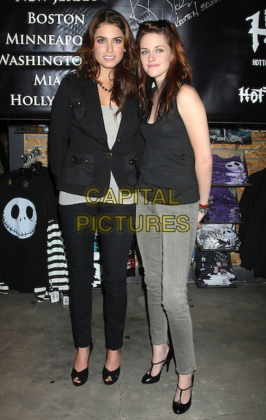 "NIKKI REED & KRISTEN STEWART .Promotional appearance for the movie ""Twilight"" at the Hot Topic store.at the Garden State Plaza Mall, .New York, NY, USA, .November 14th 2008..signing full length vest tank grey gray top black jacket necklace jeans trousers pants open toe shoes t-bar.CAP/LNC/LOU.©LNC/Capital Pictures"