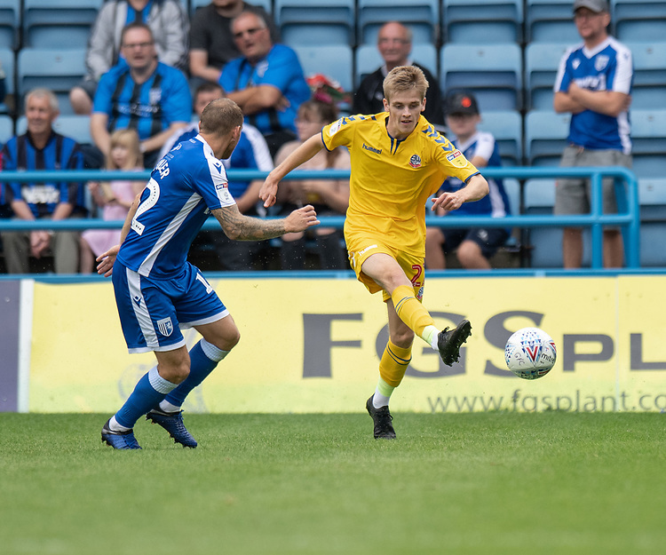 Bolton Wanderers' Ronan Darcy (right) crosses the ball despite the attentions of Gillingham's Barry Fuller (left) <br /> <br /> Photographer David Horton/CameraSport<br /> <br /> The EFL Sky Bet League One - Gillingham v Bolton Wanderers - Saturday 31st August 2019 - Priestfield Stadium - Gillingham<br /> <br /> World Copyright © 2019 CameraSport. All rights reserved. 43 Linden Ave. Countesthorpe. Leicester. England. LE8 5PG - Tel: +44 (0) 116 277 4147 - admin@camerasport.com - www.camerasport.com