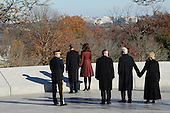 United States President Barack Obama and First Lady Michelle Obama and former President Bill Clinton and former Secretary of State Hillary Clinton looks at quotes inscribed at the at the gravesite for President John F. Kennedy, after laying a wreath, at Arlington National Cemetery in Arlington, Virginia, November 20, 2013. This Friday will mark the 50th anniversary of the assassination of President Kennedy.<br /> Credit: Pat Benic / Pool via CNP