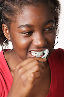 Montreal QC CANADA -Model Release Illustration Photo -<br /> Teenager female putting toothpast on a tootbrush and brushing her teeth