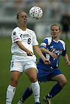11 June 2003: Lori Lindsey (6) with Unni Lehn (rear). The Carolina Courage defeated the Washington Freedom 3-0 at SAS Stadium in Cary, NC in a regular season WUSA game..Mandatory Credit: Scott Bales/Icon SMI