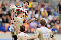 Houston, TX - Friday December 11, 2016: Drew Skundrich (12) of the Stanford Cardinal wins a header over Ian Harkes (16) of the Wake Forest Demon Deacons at the NCAA Men's Soccer Finals at BBVA Compass Stadium in Houston Texas.
