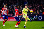 Thomas Lemar of Atletico de Madrid (L) in action against Sergi Roberto Carnicer of FC Barcelona (R) during the La Liga 2018-19 match between Atletico Madrid and FC Barcelona at Wanda Metropolitano on November 24 2018 in Madrid, Spain. Photo by Diego Souto / Power Sport Images