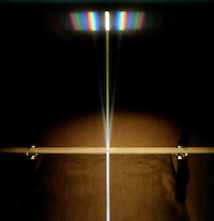 WHITE LIGHT PASSES THROUGH A DIFFRACTION GRATING<br /> Diffraction Of White Light Forms A Spectrum<br /> A single slit of white light passes through a diffraction grating to create a spectral Fraunhofer diffraction pattern.
