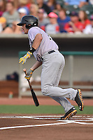 Jacksonville Suns first baseman Brady Shoemaker #20 swings at a pitch during a game against the Tennessee Smokies at Smokies Park July 10, 2014 in Kodak, Tennessee. The Suns defeated the Smokies 6-5. (Tony Farlow/Four Seam Images)