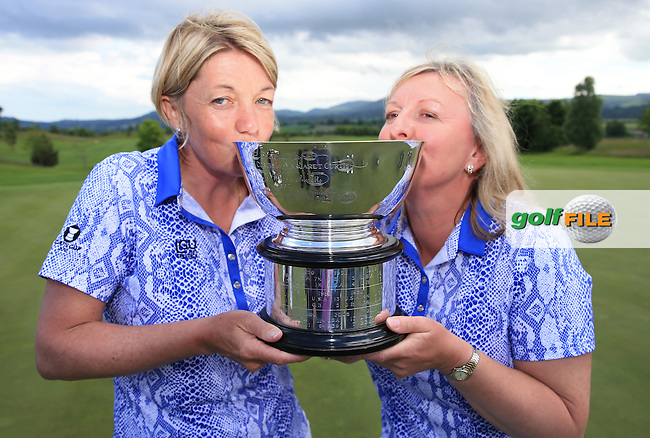 Team Captain Elaine Farquharson-Black and Helen Hewlett kissing the 2016 Curtis Cup, played at Dun Laoghaire GC, Enniskerry, Co Wicklow, Ireland. 12/06/2016. Picture: David Lloyd | Golffile. <br /> <br /> All photo usage must display a mandatory copyright credit to &copy; Golffile | David Lloyd.