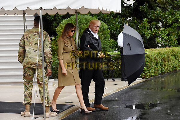 United States President Donald J. Trump walks with first lady Melania Trump prior to their Marine One departure from the White House September 2, 2017 in Washington, DC. The President and first lady are traveling to Texas to visit individuals impacted by Hurricane Harvey. <br /> CAP/MPI/RS<br /> &copy;RS/MPI/Capital Pictures