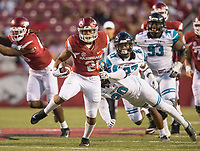 Hawgs Illustrated/BEN GOFF <br /> Devwah Whaley, Arkansas running back, breaks the tackle of Fitz Wattley, Coastal Carolina safety, in the fourth quarter Saturday, Nov. 4, 2017, at Reynolds Razorback Stadium in Fayetteville.