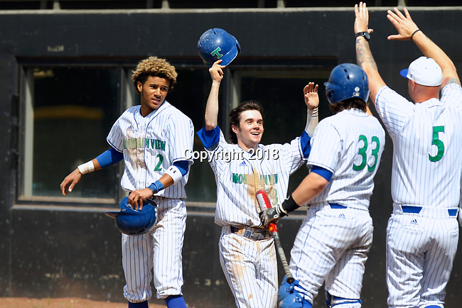 Mountain View outfielder Garrett Moen, center, is greeted by teammates after scoring against Yelm in a 3A bi-district baseball tournament game  at Propstra Stadium. (Steve Dipaola for the Columbian)