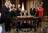 United States President Barack Obama, center, is applauded by, from left to right, U.S. Senate Majority Leader Harry Reid (Democrat of Nevada), U.S. Senator Lamar Alexander (Republican of Tennessee), U.S. Senator Chuck Schumer (Democrat of New York), U.S. Vice President Joe Biden, U.S. House Speaker John Boehner (Republican of Ohio), U.S. House Majority Leader Eric Cantor (Republican of Virginia) and U.S. House Minority Leader Nancy Pelosi (Democrat of California) while signing a proclamation to commemorate the inauguration, entitled a National Day of Hope and Resolve, directly after swearing-in ceremonies in the U.S Capitol in Washington, January 21, 2013..Credit: Jonathan Ernst / Pool via CNP