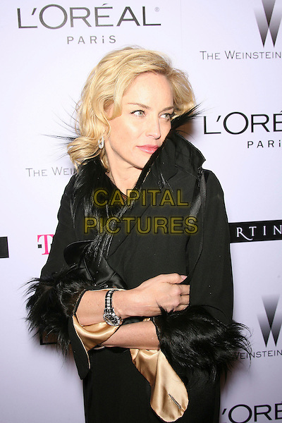SHARON STONE.The Weinstein Company's 2007 Golden Globes After Party held at Trader Vic's at the Beverly Hilton Hotel, Beverly Hills, California, USA, 15 January 2006..half length black coat fur collr cuffs trim.CAP/ADM/ZL.©Zach Lipp/AdMedia/Capital Pictures.