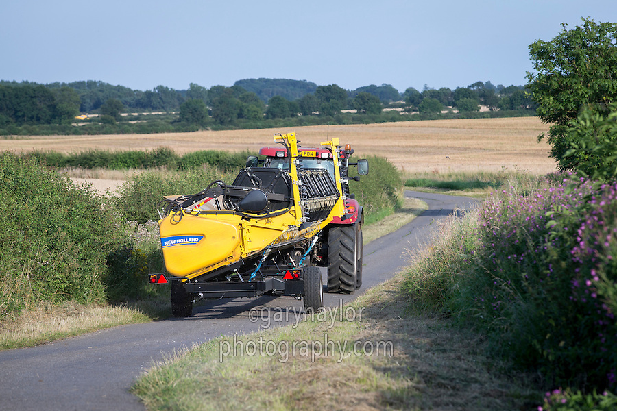 Transporting combine header on a header trailer on the raod - Lincolnshire; August