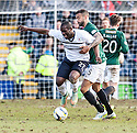 Raith Rovers' Christian Nade is puled back by Hib's Liam Fontaine.