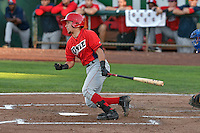 Keinner Pina (15) of the Orem Owlz follows through on his swing against the Ogden Raptors during the Pioneer League game at Lindquist Field on September 9, 2016 in Ogden, Utah. This was Game 1 of the Southern Division playoff. Orem defeated Ogden 6-5. (Stephen Smith/Four Seam Images)