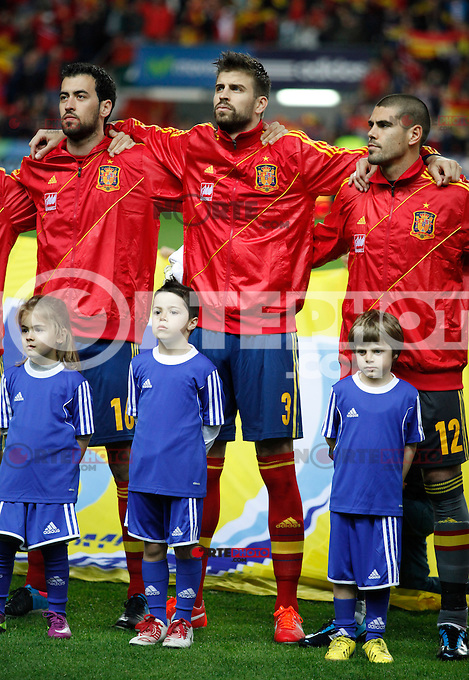 Spain's players Gerard Pique, Sergio Busquets and Victor Valdes listening to the national anthem before international match of the qualifiers for the FIFA World Cup Brazil 2014.March 22,2013.(ALTERPHOTOS/Victor Blanco)