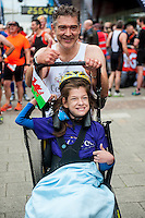 COPY BY TOM BEDFORD<br /> Sunday 26 June 2016<br /> Pictured: Poppy and dad Rob after crossing the finish line <br /> Re: A very special father-and-daughter team have tackled the Cardiff Triathlon.<br /> Poppy Jones, 11, who will be competing alongside dad Rob Jones, wants to win the event.<br /> And she's not going to let the fact that she has quadriplegic cerebral palsy , which means she can't sit, stand, roll or support herself, and chronic lung disease stop her.<br /> She will be by Rob's side every step of the way thanks to a cutting-edge wheelchair and boat – for Rob to push or pull – designed especially for the event, which sees participants take part in a swim across Cardiff Bay , a run and a bike ride.