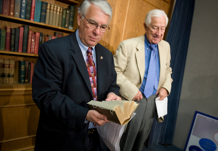 Reps. Don Manzullo, R-Ill., left, and Ralph Hall, R-Texas, read the half books that are on display in the house studio, June 19, 2009.  They were waiting for the start of  a news conference on the 1,100 page climate change legislation entitled American Clean Energy and Security Act of 2009 that they contend is being rushed through Congress by Democratic leaders.