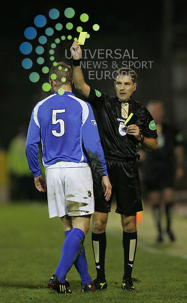 St. Johnstone  v Rangers, McDiarmid Park, Perth - 13/01/2009.Homecoming Scottish Cup Fourth round, Season 2008/09..St Johnstone's Kavin Rutkiewicz gets a yellow card after a hard tackle on Ranger's Steven Naismith.  The half time score was Rangers 1- St. Johnstone 0Picture by John Cockburn/ Universal News & Sport (Scotland)