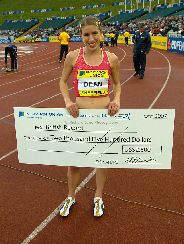 Photo: Richard Lane/Sportsbeat Images..Norwich Union British Grand Prix, Sheffield. 15/07/2007. .Hattie Dean of Great Britain with a cheque after breaking the national record in the women's 3000m steeplechase.