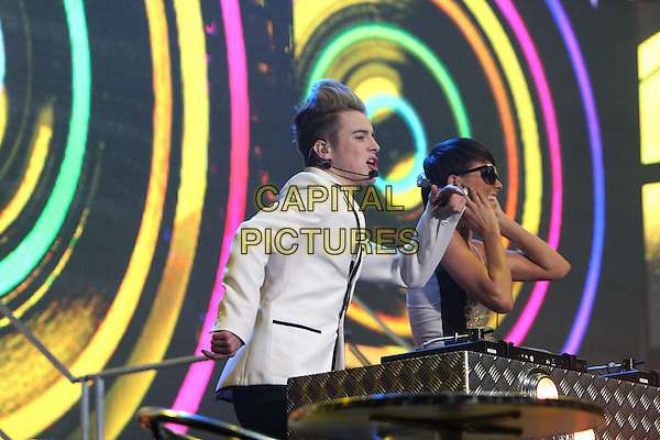 JOHN & EDWARD GRIMES aka JEDWARD.Performs on stage at the X Factor show, Wembley Arena  London, England..February 21st, 2010.stage concert live gig performance music half length black trim white suit jacket singing  dancing .CAP/MAR.© Martin Harris/Capital Pictures.