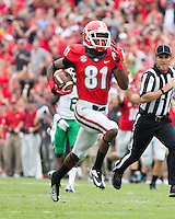 The Georgia Bulldogs played North Texas Mean Green at Sanford Stadium.  After North Texas tied the game at 21 early in the second half, the Georgia Bulldogs went on to score 24 unanswered points to win 45-21.  Georgia Bulldogs wide receiver Reggie Davis (81) runs for a touchdown.