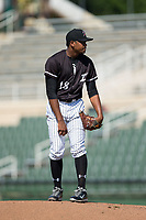 Kannapolis Intimidators starting pitcher Yosmer Solarzano (18) looks to his catcher for the sign against the Hagerstown Suns at Kannapolis Intimidators Stadium on June 15, 2017 in Kannapolis, North Carolina.  The Intimidators walked-off the Suns 5-4 in game one of a double-header.  (Brian Westerholt/Four Seam Images)