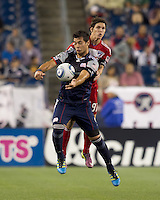 New England Revolution forward Milton Caraglio (9) and FC Dallas defender Zach Loyd (91) battle for head ball. In a Major League Soccer (MLS) match, the New England Revolution defeated FC Dallas, 2-0, at Gillette Stadium on September 10, 2011.