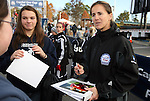 03 December 2010: Soccer legend Brandi Chastain (right) signs autographs before the game. The Notre Dame Fighting Irish defeated the Ohio State University Buckeyes 1-0 at WakeMed Stadium in Cary, North Carolina in an NCAA Women's College Cup semifinal game.