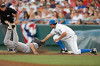 UCLA 1B Justin Uribe tags out Kyle Enders in Game One of the NCAA Division One Men's College World Series Finals on June 28th, 2010 at Johnny Rosenblatt Stadium in Omaha, Nebraska.  (Photo by Andrew Woolley / Four Seam Images)