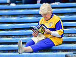 A Clare fan digests her match programme before the All-Ireland semi-final replay against Galway at Semple Stadium,Thurles. Photograph by John Kelly.