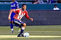 CD Chivas USA midfielder Michael Lahoud dribbles squarely into the light. The Kansas City Wizards defeated CD Chivas USA 2-0 at Home Depot Center stadium in Carson, California on Sunday September 19, 2010.