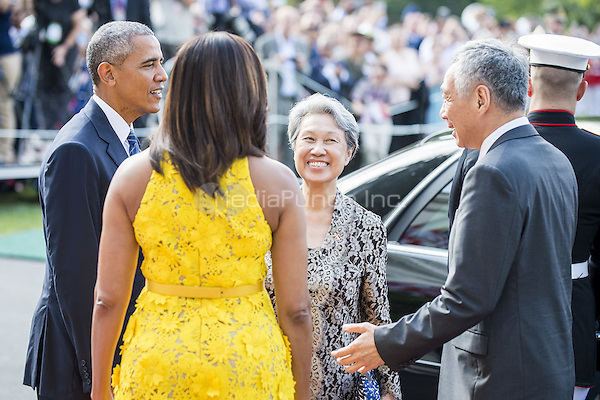 United States President Barack Obama and First Lady Michelle Obama welcome Mrs. Lee Hsien Loong and her husband Prime Minister Lee Hsien Loong of Singapore (l-r) to the White House with a ceremony on the South Lawn on August 2, 2016 in Washington, DC. The Official visit includes a State Dinner this evening.  <br /> Credit: Pete Marovich / Pool via CNP/MediaPunch