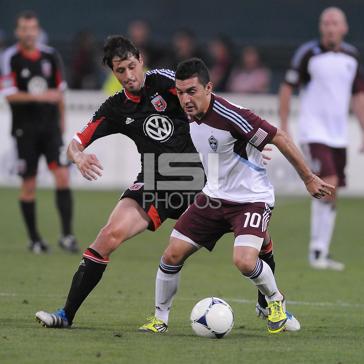 Colorado Rapids midfielder Martin Rivero (10) shields the ball against D.C. United Branko Boskovic (8) D.C. United defeated the Colorado Rapids 2-0 at RFK Stadium, Wednesday May 16, 2012.