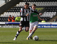 Steven Thompson challenged by Paul Hanlon in the St Mirren v Hibernian Clydesdale Bank Scottish Premier League match played at St Mirren Park, Paisley on 29.4.12.