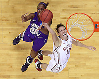 Oklahoma forward Carlee Roethlisberger (10) grabs the rebound over James Madison forward Jalissa Taylor (32) during in the first round of the NCAA women's college basketball tournament Sunday March 20, 2011 in Charlottesville, Va. Oklahoma won 86-72. (AP Photo/ Andrew Shurtleff)