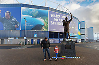 Pictured: Five year old Grace Elliott, wearing a Southampton top, leaves a Southampton scarf with her dad Chris, by the statue of Frederick Charles Keenor outside the Cardiff City Stadium in south Wales, UK. Tuesday 22 January 2019<br /> Re: Premier League footballer Emiliano Sala was on a flight which disappeared between France and Cardiff.<br /> The Argentine striker was one of two people on board the Piper Malibu, which disappeared off Alderney on Monday night.<br /> Cardiff City FC, signed the 28-year-old from French club Nantes.<br /> A search is under way.<br /> A Cardiff Airport spokeswoman confirmed the aircraft was due to arrive from Nantes but said there were no further details.<br /> HM Coastguard has sent two helicopters to help.