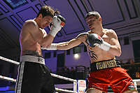 Mitchell Preedy (red shorts) defeats Scott Hillman during a Boxing Show at York Hall on 3rd March 2018