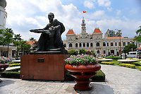 Statue of Ho Chi Minh, with the Ho Chi Minh City People's Committee Building (also known as the Saigon Town Hall, the Saigon City Hall or the Ho Chi Minh City Hall) in the background. Ho Chi Minh City (Saigon), Vietnam