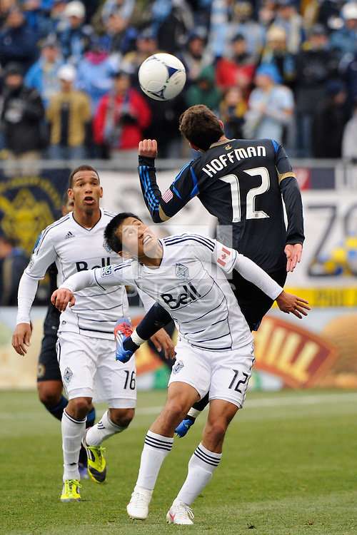 Young-Pyo Lee (12) of the Vancouver Whitecaps watches Chandler Hoffman (12) of the Philadelphia Union head the ball. The Philadelphia Union and the Vancouver Whitecaps played to a 0-0 tie during a Major League Soccer (MLS) match at PPL Park in Chester, PA, on March 31, 2012.