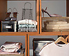 Storage comparmtnets with lady's clothing & accessories.