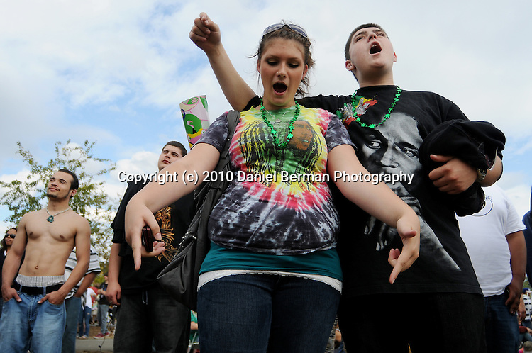 Seattle Hempfest - August 21-22, 2010 in Myrtle Edwards Park. Stefani Griffith, left, and Michael Solvang, engaged, react to a speech by activist Rick Steves, in which he called for more reasonable marijuana reform, on the second day of Hempfest. This was her 2nd time attending and his first. Photo by Seattle photographer Daniel Berman