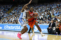 CHAPEL HILL, NC - JANUARY 11: Aamir Simms #25 of Clemson University charges past Leaky Black #1 of the University of North Carolina during a game between Clemson and North Carolina at Dean E. Smith Center on January 11, 2020 in Chapel Hill, North Carolina.