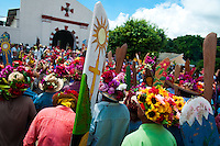 "The Corpus Christi procession participants gathered in front of the Church of Atanquez, Sierra Nevada, Colombia, 3 June 2010. A colorful celebration of Corpus Christi is held in the Kankuamo Indians territory every year. ""The Dance of the Devils"" is an ancient tradition kept for centuries on the Colombia's Caribbean coast. This Christian religious event usually coincides with the summer solstice, which has always been the key point for the native cultures and for the black African slaves. Due to this confluence, the Kankuamo myths, the African animistic rites and other Pre-Columbian features have blended with the Spanish Catholic festival into a lively spectacle."