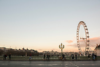 The London Eye and Westminster Bridge at sunset, South Bank, London, England